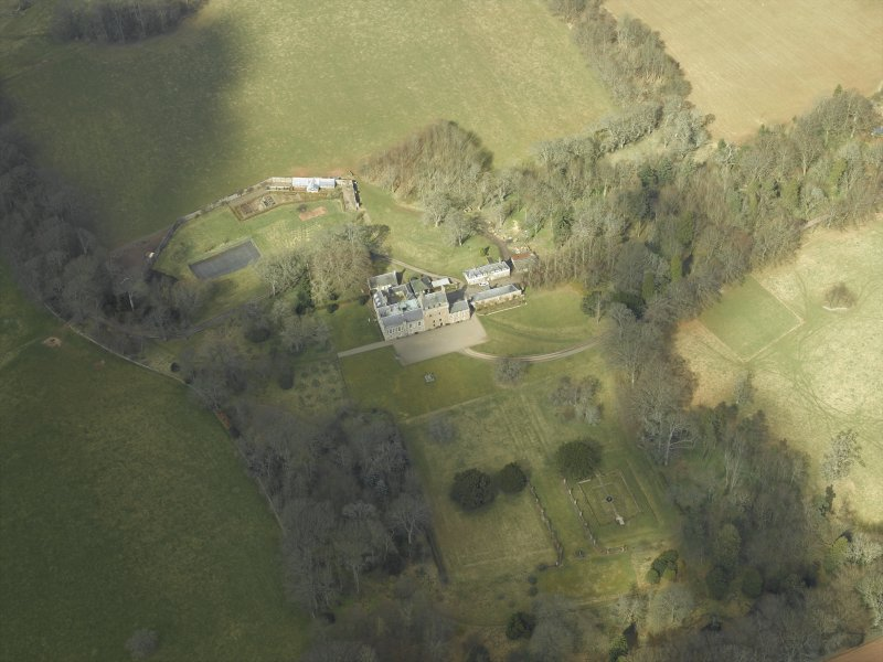 Oblique aerial view centred on the country house and gardens, taken from the SSE.