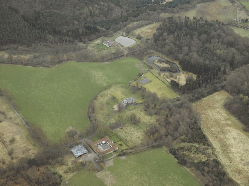 Oblique aerial view centred on the country house, walled garden, farmsteading, stables and dovecot, with the farmstead and corn mill adjacent, taken from the NW.