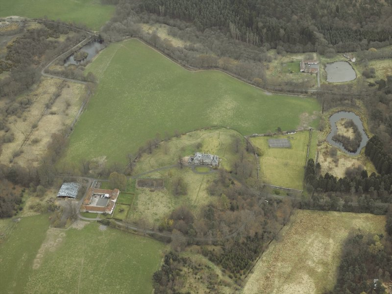Oblique aerial view centred on the country house, walled garden, farmsteading, stables and dovecot, with the farmstead and corn mill adjacent, taken from the W.