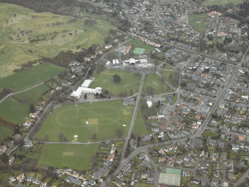 General oblique aerial view centred on the school and swimming pool, taken from the WSW.