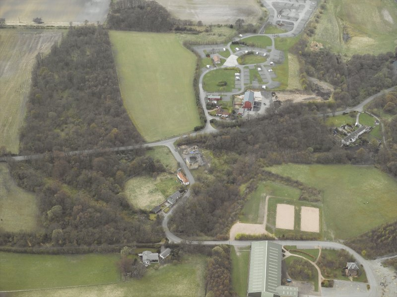 Oblique aerial view centred on the tower-house, taken from the ENE.