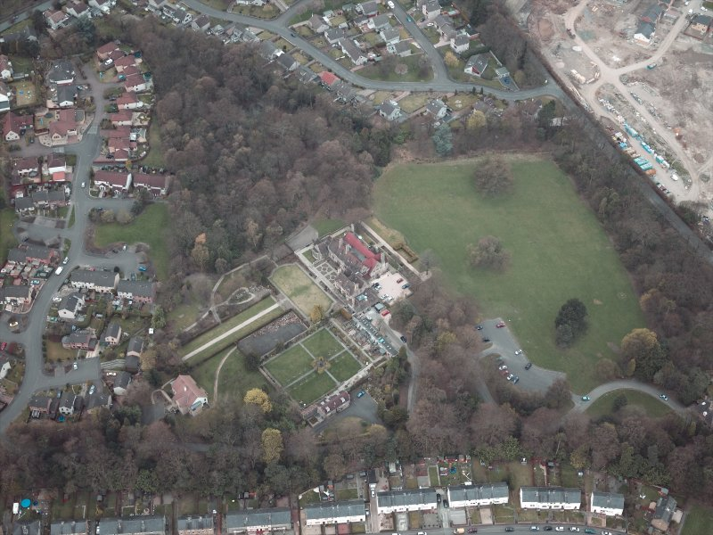 Oblique aerial view centred on the house and walled garden, taken from the E.