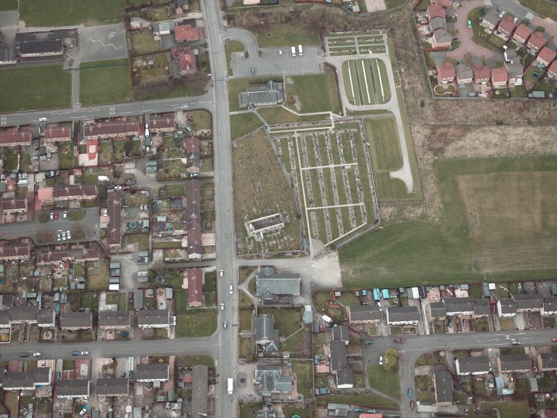 Oblique aerial view centred on the churches, burial-ground and church hall, taken from the S.