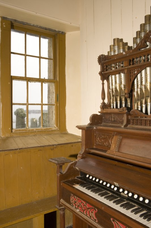 Interior. Detail of window and organ