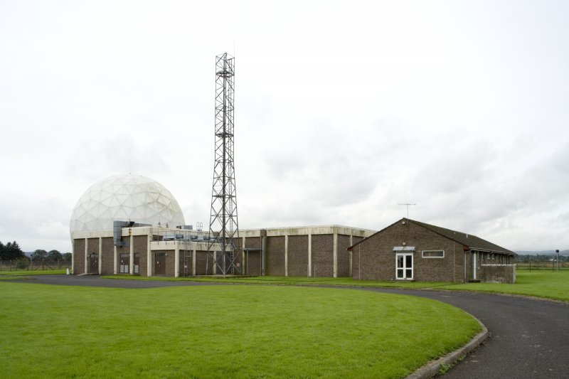 View.  Radome, main building, communications mast and administration block from NE.