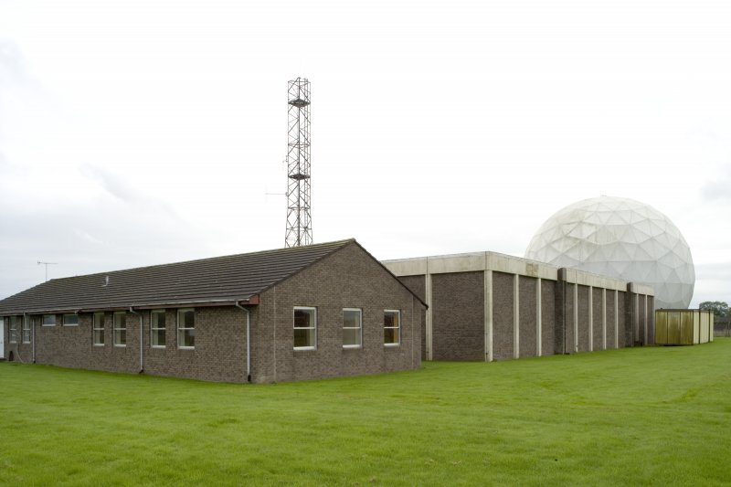 View.  Adminstration and mess lounge from NW.  Main control building, communication mast and radome in background.