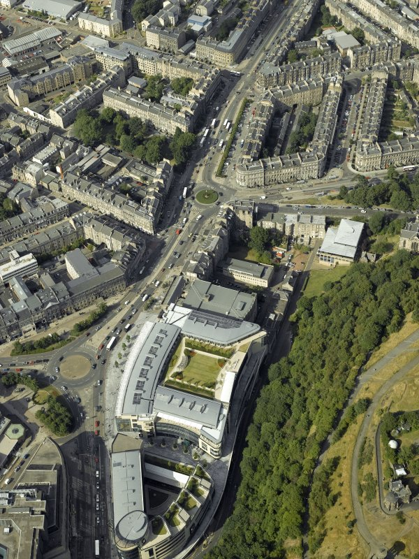 Oblique aerial view centred on the hotel, cinemas and theatre, taken from the SSW.