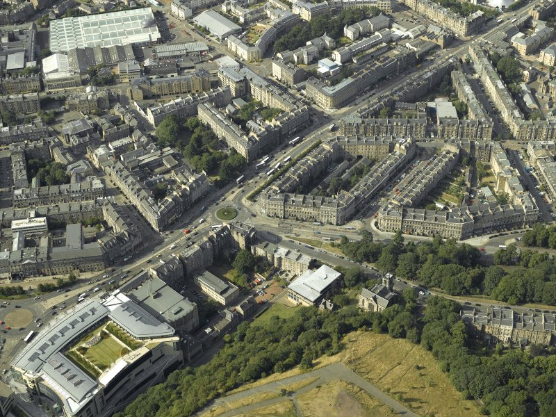 Oblique aerial view centred on the hotel, cinemas and theatre, taken from the SSE.