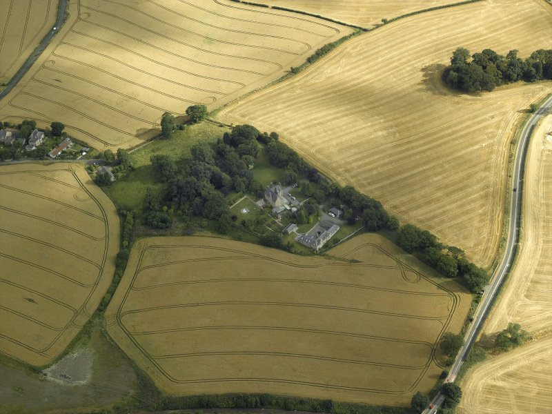 Oblique aerial view centred on the Laird's house, dovecot and walled garden, taken from the NW.