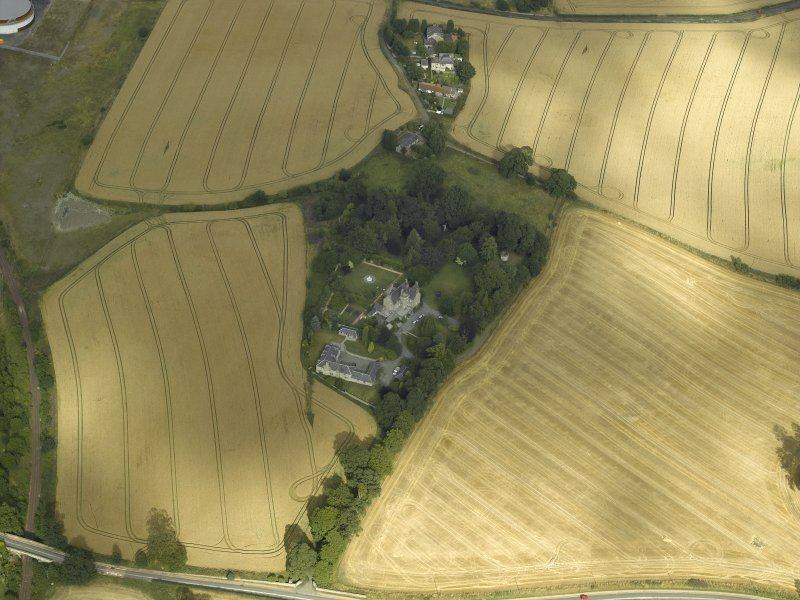 Oblique aerial view centred on the Laird's house, dovecot and walled garden, taken from the WSW.