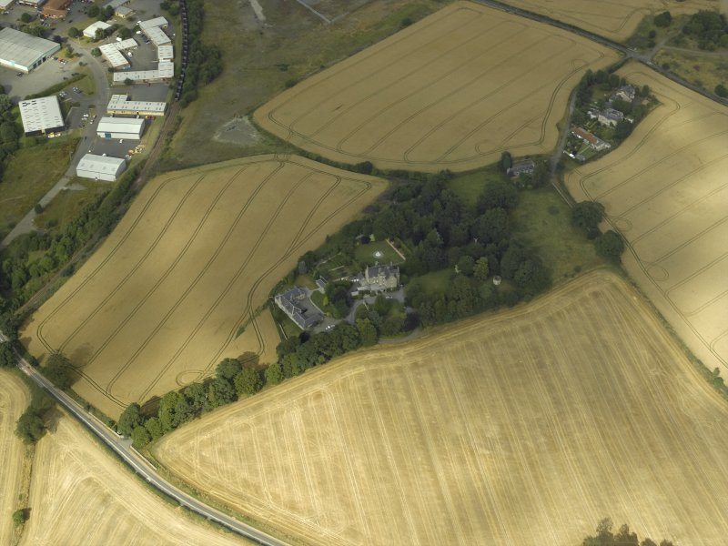 Oblique aerial view centred on the Laird's house, dovecot and walled garden, taken from the SW.