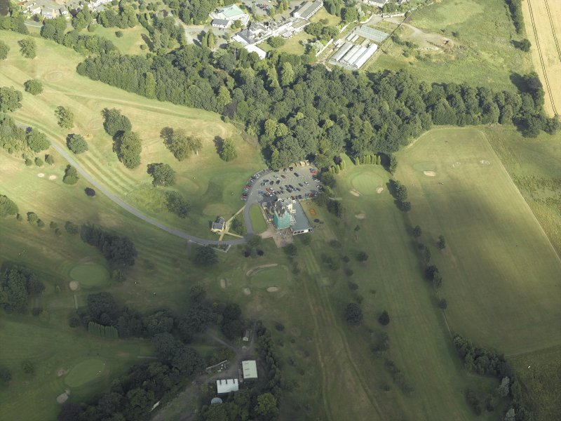 Oblique aerial view centred on the tower-house and golf club, taken from the W.
