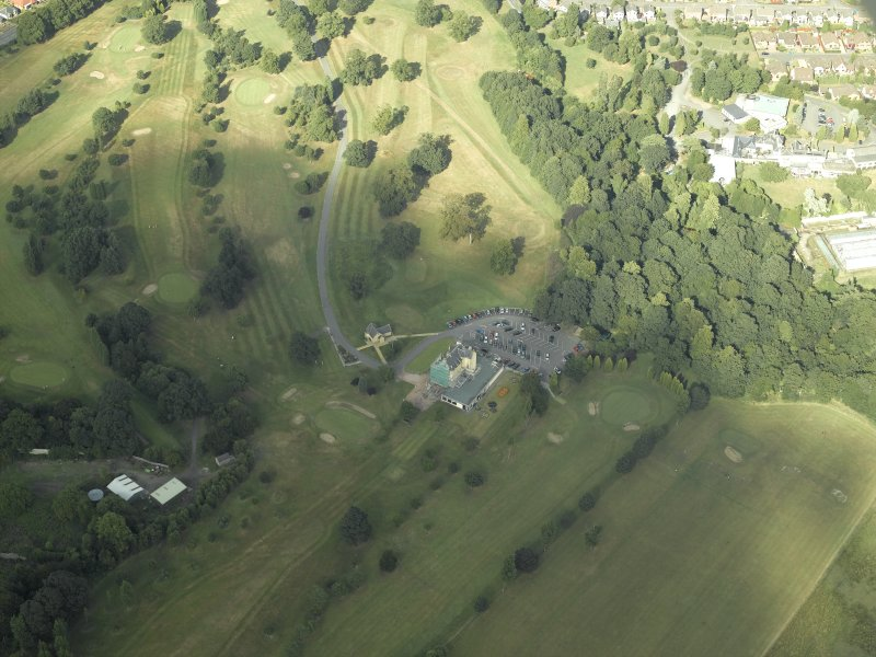 Oblique aerial view centred on the tower-house and golf club, taken from the SW.