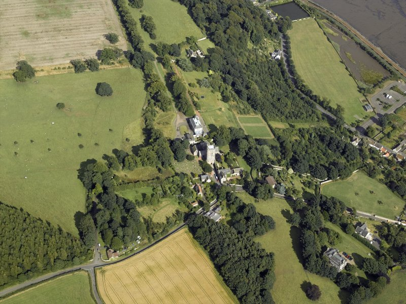 General oblique aerial view centred on the abbey, church, manse, burial-ground, school and country house, taken from the W.
