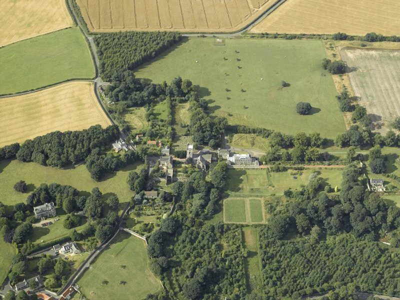 General oblique aerial view centred on the abbey, church, manse, burial-ground, school and country house, taken from the SSE.