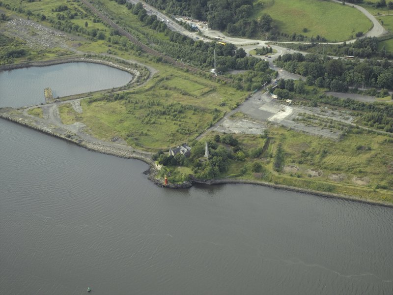 Oblique aerial view of the remains of the shipyard centred on the castle, taken from the SE.