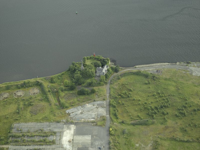 Oblique aerial view of the remains of the shipyard centred on the castle, taken from the N.