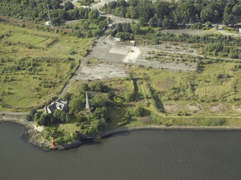 Oblique aerial view of the remains of the shipyard with the castle adjacent, taken from the S.