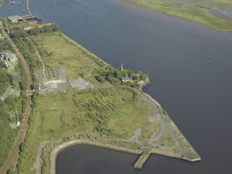 General oblique aerial view of the remains of the shipyard centred on the castle, taken from the WNW.