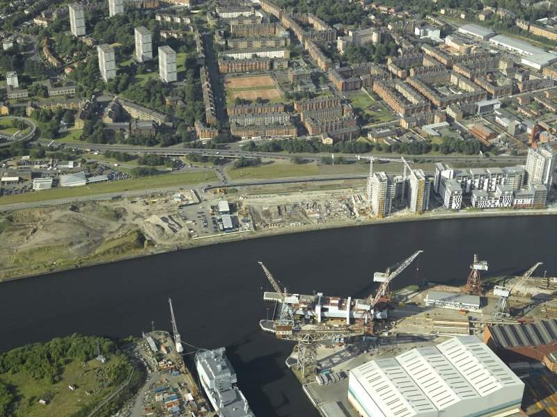 Oblique aerial view of the quay with the flats and shipyard adjacent, taken from the SSW.