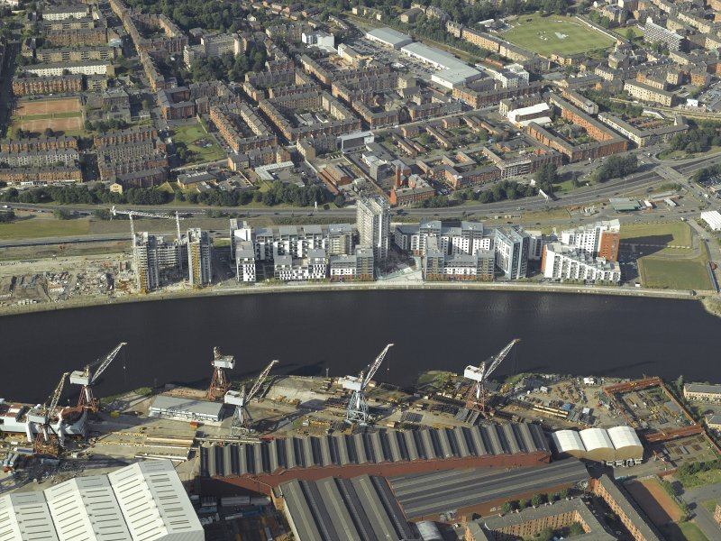 Oblique aerial view of Meadowside quay, Glasgow, centred on the flats with the Fiarfield shipyard adjacent, taken from the S.