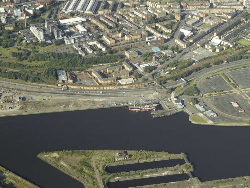 Oblique aerial view of the quay centred on the tall ship, taken from the SSW.