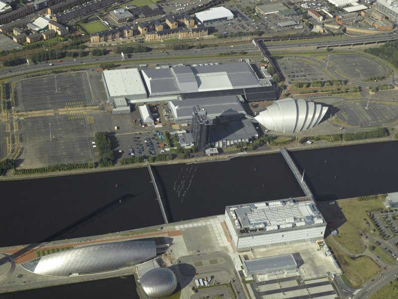 Oblique aerial view of the River Clyde centred on the bridges with the exhibition centre and science centre adjacent, taken from the SSW.
