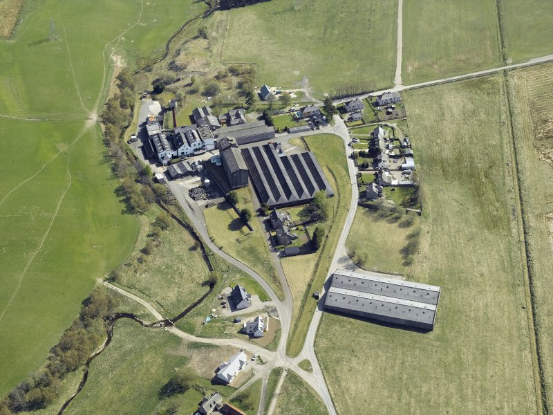 Oblique aerial view of Balmenach whisky distillery, taken from the N.