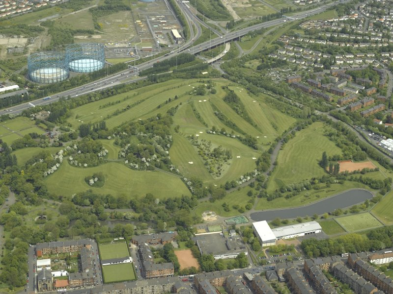 General oblique aerial view of the park and golf course with the gasworks adjacent, taken from the S.