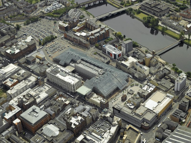 General oblique aerial view centred on the shopping centre with the bridges adjacent, taken from the N.