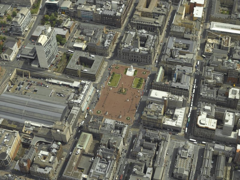 Oblique aerial view centred on the city chambers and square, taken from the W.
