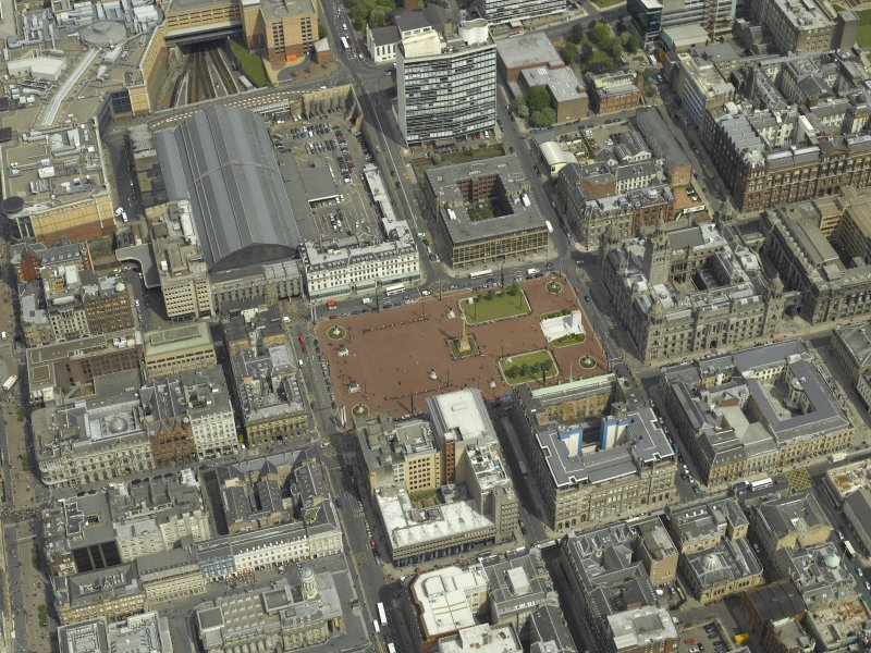 Oblique aerial view centred on the city chambers and square with the station adjacent, taken from the SSW.