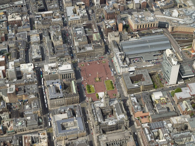 Oblique aerial view centred on the city chambers and square with the station adjacent, taken from the SE.