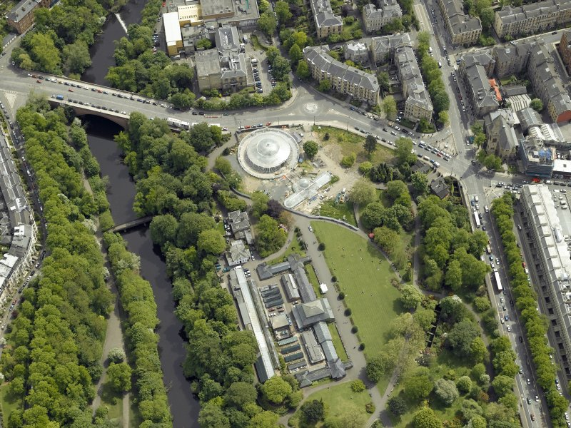 Oblique aerial view centred on the botanic gardens, glasshouses and conservatory, taken from the NW.