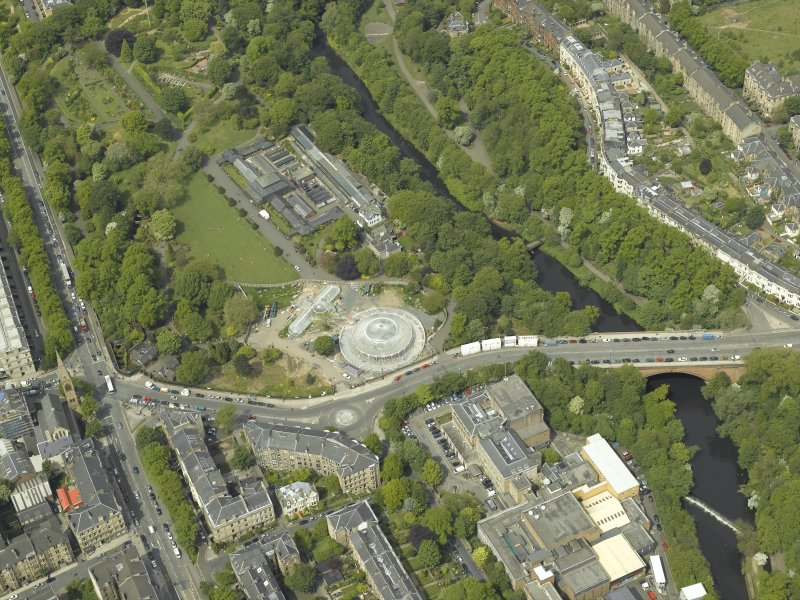 Oblique aerial view centred on the botanic gardens, glasshouses and conservatory, taken from the SSE.