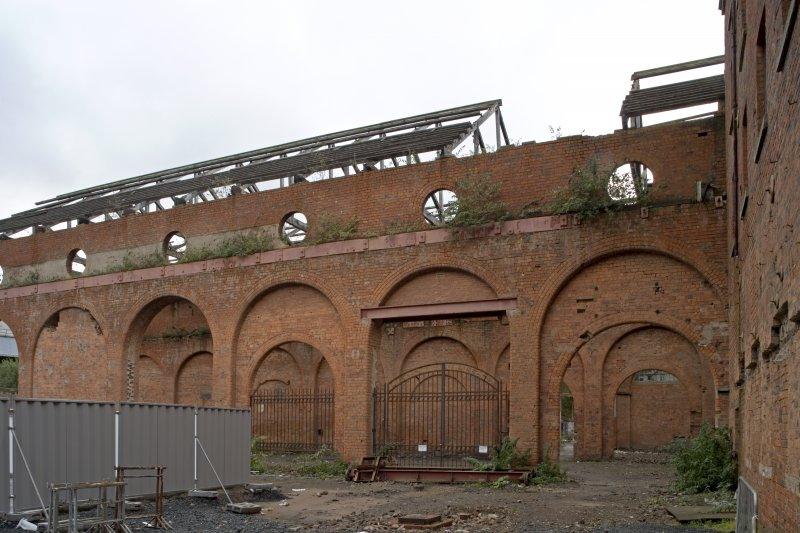 View of brick-arched former internal walls of the heavy machine shop (former erecting shop). Note oculi with iron rail above the relieving arches (some pierced)