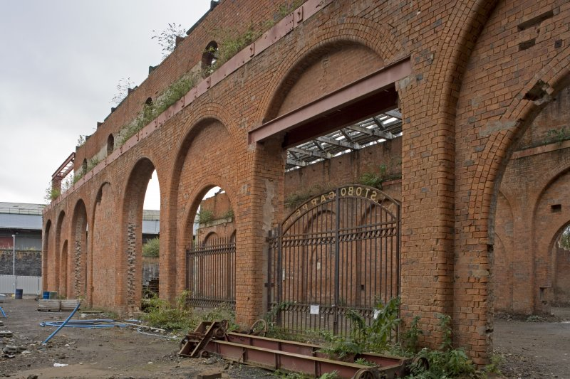 View of former internal pierced brick-arched internal walls of the former heavy engineering shop at the Eglinton Engine Works.