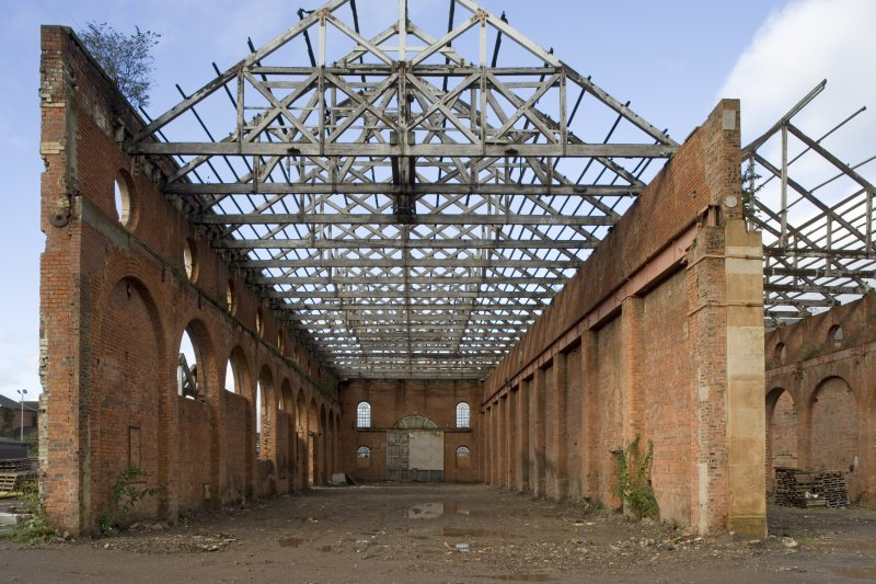 Interior. View of light machine shop (former boiler shop) from Eshowing S wall parapet oculi, and roof structure during conversion work