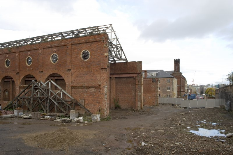 View of S wall of light machine shop (former boiler shop), heavy machine shop and stone ashlar range to the N