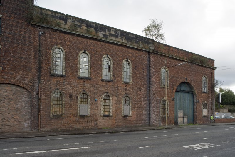 View of West Street elevation from NW showing heavy machine shop (former erecting shop, left c. 1866-8) and light machine shop (former boiler shop (l, right, mid 1870s) with original timber door). Note the windows with dressed stone margins and keystones