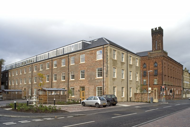 View from SE of brick-built rear elevation of converted Cook Street range