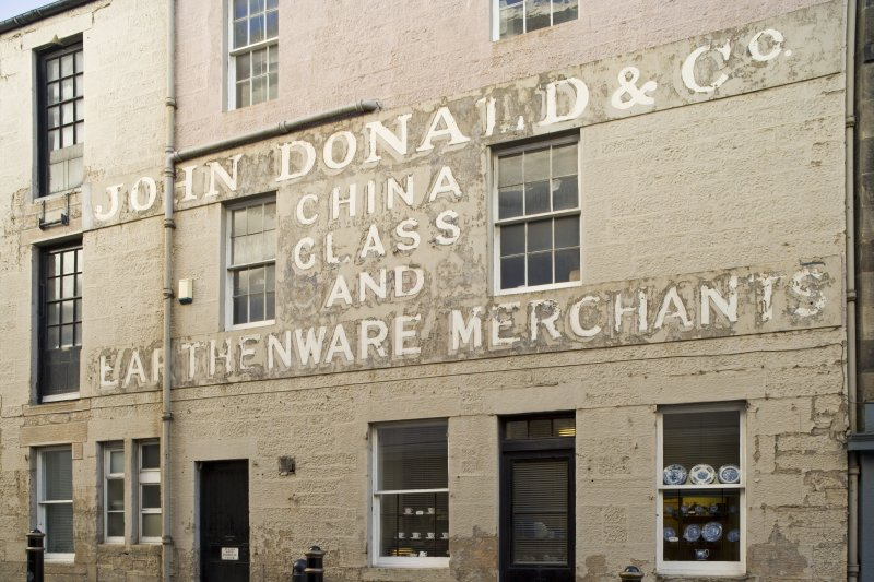 Detail of Bristo Port frontage showing painted signage from NW, J Donald & Co, Edinburgh.