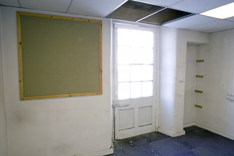 Interior. 2nd floor. N side  Room showing former crane hoist door and wall press (recess).