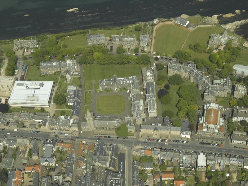 Oblique aerial view centred on the church, hall and colleges, taken from the S.