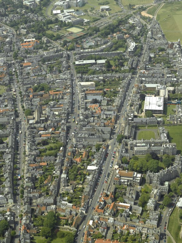 General oblique aerial view of the town centred on the churches and colleges, taken from the ENE.
