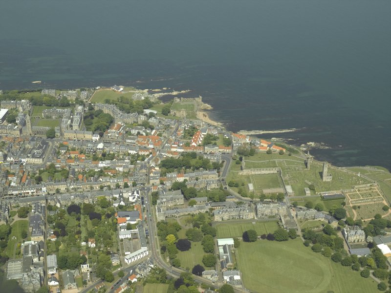 General oblique aerial view of the town centred on the remains of the cathedral and castle, taken from the S.
