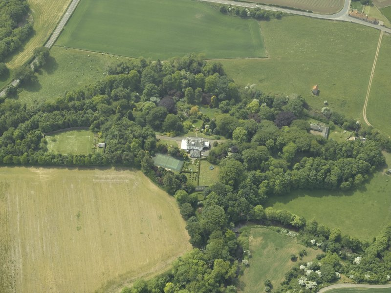 General oblique aerial view centred on the country house and walled garden with the dovecot adjacent, taken from the ENE.