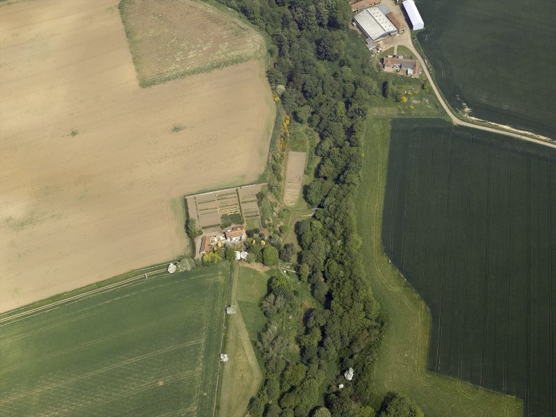 Oblique aerial view centred on the house with the road bridge adjacent, taken from the SSW.