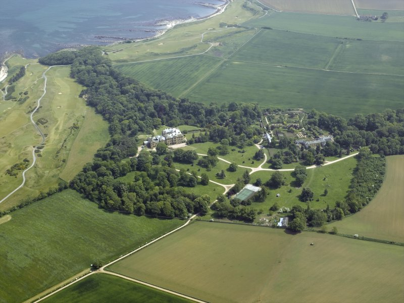General oblique aerial view centred on the country house, walled gardens and stables, taken from the W.