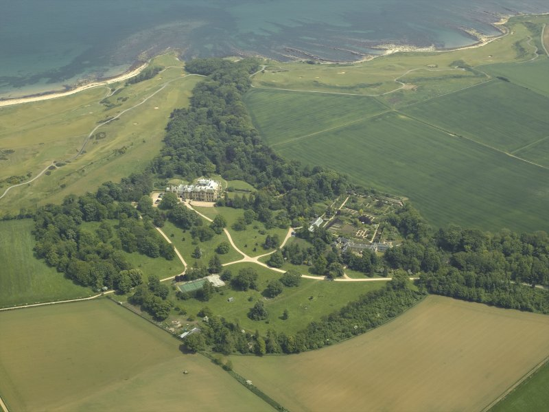 General oblique aerial view centred on the country house, walled gardens and stables, taken from the WSW.